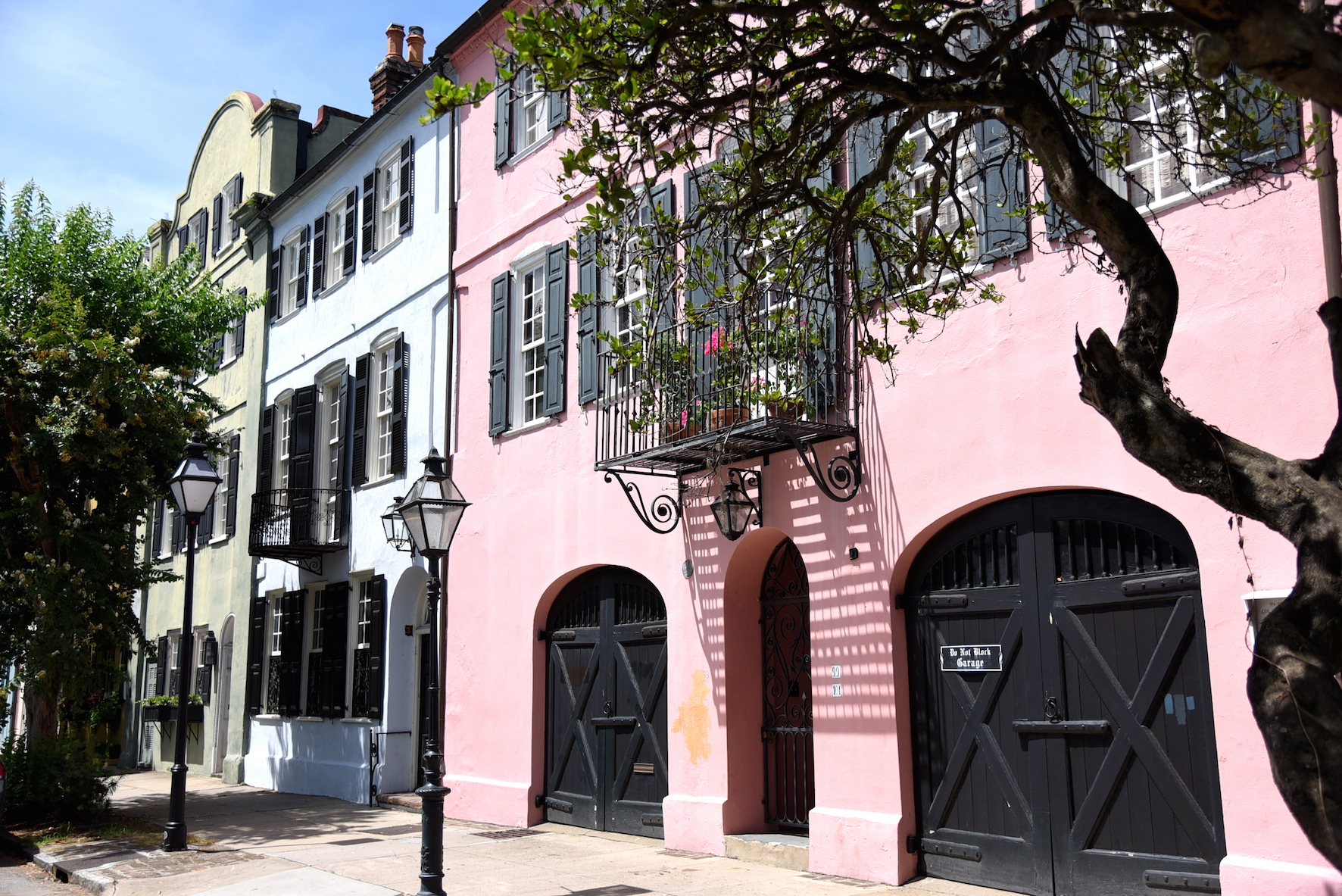 Pink pastel houses of the Rainbow Row in Charleston, USA